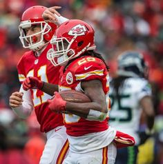 Kansas City Chiefs quarterback Alex Smith (11) congratulated Kansas City Chiefs running back Jamaal Charles (25) after Charles' 16-yard, second quarter touchdown against the Seattle Seahawks during NFL action on November 14, 2014 at Arrowhead Stadium in Kansas City, Mo. The Chiefs won 24-20.
