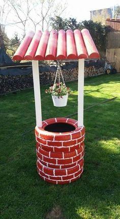 DIY GARDEN: re-purposing old tires so as to make a lovely yard decor - a charming little well that might shelter a flower clump. Diy Garden Projects, Garden Crafts, Diy Garden Decor, Garden Decorations, Holiday Decorations, Yard Art Crafts, Amazing Gardens, Beautiful Gardens, Tire Craft