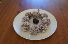 Healthy cherry ripe balls - ripe juicy cherries, coconut and chocolate.