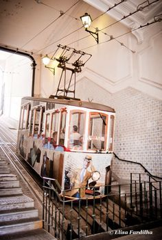 Travel Inspiration for Portugal - The lift da Bica, inaugurated in 1892, is one of the major tourist attractions of Lisbon. It was electrified only in 1914, and is considered a national monument since 2002.
