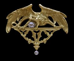 IMPORTANT GOTHIC CHIMERA Pendant/Brooch  Gold with Victorian cut diamonds 0.40 cts & 0.10 cts approx.  H  4.70 cm (1.85 in)  |  W  5.60 cm (2.20 in) Origin France, c. 1880