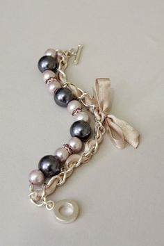 Grey, light lilac pearls and beige ribbon bracelet