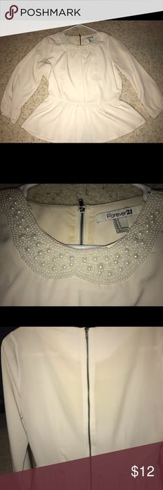 Forever 21 cream peplum shirt with pearl collar cute with black jeans or shorts. can be dressed up or worn more casual. super cute just not my style anymore. Forever 21 Tops Blouses