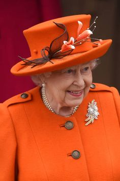 Same orange coat. Queen Elizabeth II leaves the Christmas Day morning church service at St Mary Magdalene Church in Sandringham, Norfolk. (Photo by Joe Giddens/PA Images via Getty Images) Dec. Windsor, Meghan Markle, God Save The Queen, Palais De Buckingham, Queen Hat, Queen Outfit, Foto Real, Royal Queen, Isabel Ii