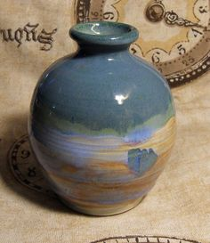 Reverse Jupiter Decorative Ceramic Vase by brambledragon on Etsy, $15.00