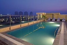 The beautiful poolside is as inviting in summers as in winters at Country Inn & Suites By Carlson, Sector 29, Gurgaon