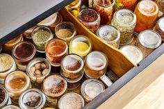 """David stores his spices in jars arrayed upside-down in the dresser's top drawer. """"That way I can see what I've got, and I don't have to bother with labeling the jars,"""" he says."""