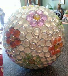 Daisy gem bowling ball yard art.