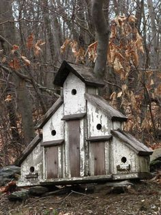 Old tiered bird house. Wish my cats didn't destroy every bird in our yard :(