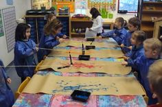 painting in pairs with a paintbrush attached to a piece of string