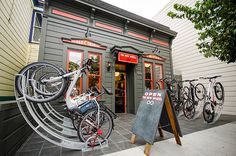 Bike Arc bicycle racks in front of The New Wheel bike shop in San Francisco, via @momentummag