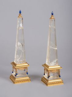 PAIR OF ROCK CRYSTAL OBELISKS each obelisk topped  lapis lazuli pearl & resting on 24 carat gold ormolu bronze