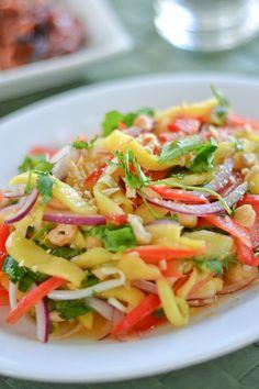 Thai Green Mango Salad. Mango, red pepper, red onion, coriander, basil, dry roasted cashews/peanuts. Dressing: Fish sauce, honey, lime juice, red chilli.