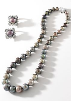 Cartier London - A Highly Important, Rare and Superb Natural Pearl and Diamond Necklace; and Pair of Natural Pearl and Diamond Earclips, mounts by Cartier London. Provenance: Viscountess Cowdray, Lady Pearson. 2 pearls from this strand after 1937 were mounted into a pair of earrings by Cartier. These and 2 other pearls from another antique jewel was recently re-strung back to its original number of 42 pearls - 'to make it a superb layout of historic pearls'