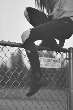 Why is she hopping the fence? Going to something illegal, or running from Something?