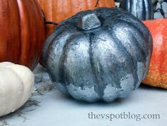 The V Spot: Make faux Mercury Glass pumpkins out of Dollar Store cheesiness.