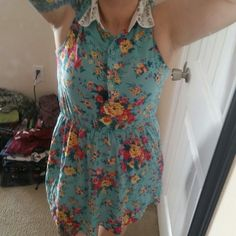 """Floral dress with metal studded collar. Small, but fits as a Med. I'm 5'2"""" button front. No trades Dresses"""