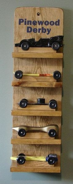 Scout Pinewood Derby Car Display Shelf - I like this idea, but also adding the dens symbols and labels for each year. Cub Scouts Wolf, Tiger Scouts, Cub Scout Crafts, Cub Scout Activities, Scout Mom, Girl Scouts, Pinewood Derby Cars, Wood Projects For Kids, Scout Camping