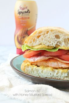 Salmon BLT with Honey Mustard Spread - The classic BLT sandwich is amped up with healthy salmon and Sabra honey mustard spread. SO good! Recipe on CookingWithBooks.net