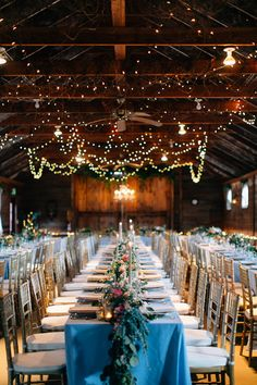 barn wedding reception - photo by Lora Grady Photography http://ruffledblog.com/fairytale-cottage-wedding-at-craven-farm