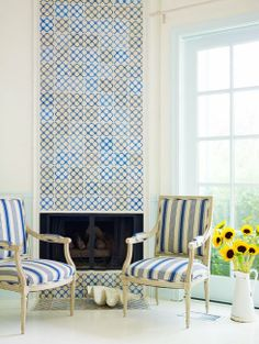 This fireplace covered in Portuguese antique tiles is so fantastic. It is in a Venice Beach home featured in interior designer Alexandra Angle's portfolio. Lots of Swedish homes have tiled fireplaces. This is reminiscent of that look except the house is in California and the tiles are from Portugal!  Notice how the tiles replace the need for art on the walls in this space.