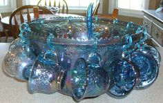 I actually HAVE this punch bowl, but I don't have the cups and ladle for it! :( (Indiana Blue Carnival Glass Punch Bowl Set)