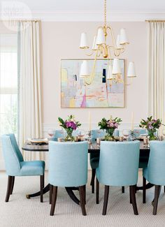 The homeowners' mahogany dining table was stained an espresso shade to match the legs of the dining chairs, while the chandelier, a contemporary take on a traditional tiered fixture, ties into the gilt antiques. These elegant Old World touches keep the blush and turquoise colours looking timeless. | Image: Stacy Zarin Goldberg | Designer: Erica Burns | #BoldInterior #DiningRoom #StyleAtHome