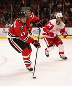 CHICAGO, IL - SEPTEMBER 17: Sheldon Brookbank #17 of the Chicago Blackhawks passes next to Todd Bertuzzi #44 of the Detroit Red Wings during...