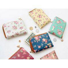 Wanna This Pour vous flower pattern half zip around wallet (http://www.fallindesign.com/wanna-this-pour-vous-flower-pattern-half-zip-around-wallet/)