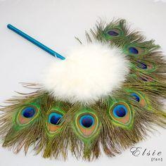 Elsie Feather Fan  http://www.brittenweddings.co.uk/shopbritten/feather-fans/elsie-wedding-bridal-peacock-feather-fan/