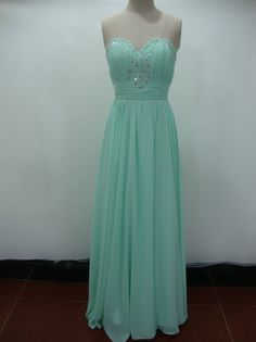 beautiful - plus the beading/sparkly embellishments on the bodice -  Mint green prom dress