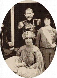 King Ferdinand and Queen Marie of Romania, photographed in Belgrade in 1923 at the christening of her grandson Prince Peter of Yugoslavia. Standing right is The Duchess of York(who would later be known as the queen mother) Romanian Royal Family, Duchess Of York, North And South America, Queen Mother, Royal House, Royal Jewels, Belgrade, British Monarchy, My Heritage