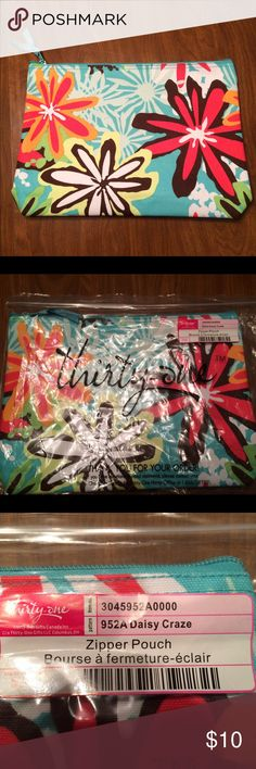 """Thirty-One Zipper Pouch Daisy Craze Brand new Thirty-One Zipper Pouch in bag never used  Approx. 9""""H x 12.25""""Lx2""""D Thirty-One Bags Cosmetic Bags & Cases"""