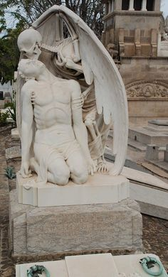 World Of Mysteries: The Kiss of Death Statue at the Old Graveyard of Poblenou in Barcelona