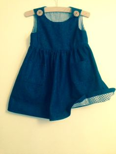 Pinafore with gingham trim.