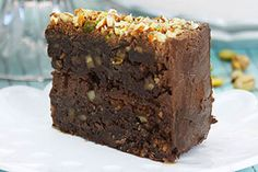 Extra chocolate and pudding mix in the batter makes this fudge cake extra rich and moist. This recipe is finished with a chocolate frosting and a combination of pistachios, almonds and walnuts sprinkled on the top of the cake. Peanut Butter Hot Chocolate Recipe, Chocolate Fudge Cake, Homemade Hot Chocolate, Hot Chocolate Recipes, Chocolate Flavors, Chocolate Frosting, Chocolate Pudding, Kraft Recipes, Cake Recipes