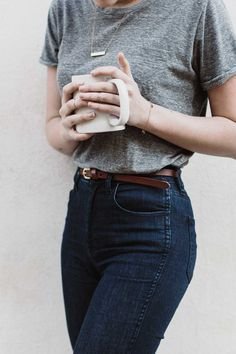 Classic look. Simple and sophisticated with a high wasted jean, thin brown belt, grey tee, and cute necklace