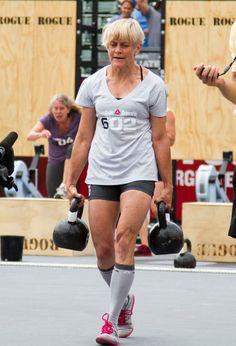 I want to be this lady someday: This woman is Betsy Finley. She's over 60 years old and carrying about 50lbs in each hand. She won the 2011 CrossFit games in her age class. That is one kickass woman.