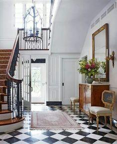 Incredible foyer - black and white tiled floor
