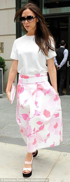 Tickled pink: The mother-of-four a pair of light pink wedged shoes in lieu of her usual ch...