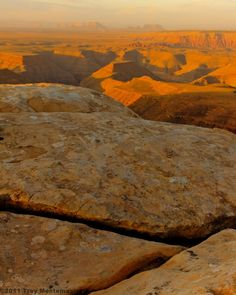 Slabs of de Chelly sandstone on the edge of Cedar Mesa at Muley Point high above the Goosenecks of the San Juan River and Monument Valley.