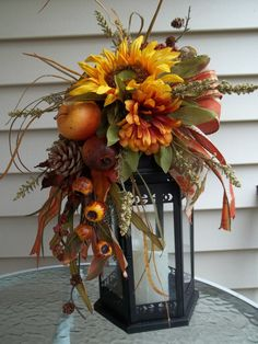Thanksgiving flowers are a wonderful way to brighten up your dining room during your Thanksgiving holiday dinner. Fall Lantern Centerpieces, Fall Lanterns, Christmas Lanterns, Thanksgiving Decorations, Christmas Decorations, Fall Arrangements, Autumn Decorating, Autumn Wreaths, Arte Floral