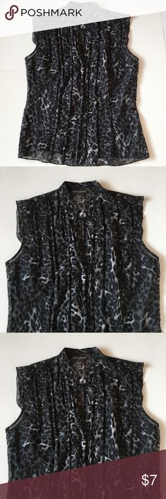 Banana Republic medium sheer top Banana Republic medium sheer top.   Black and gray animal print.  70% cotton 30% silk.  Low v neck with tie  front. Perfect with suit.  Smoke free home Banana Republic Tops Blouses