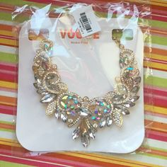 """Large Statement Necklace I received this as a gift for my birthday and it's just too """"statement"""" for me. Very detailed and beautiful. Never worn and in original packaging. One gem is missing as seen in picture but that does not take away from the piece. Vogue Jewelry Necklaces"""