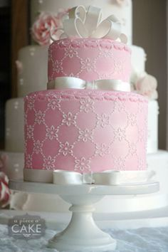 Pink cake <3 - would do gold glittery bows and just a little bit more vibrant pink for Sam's party