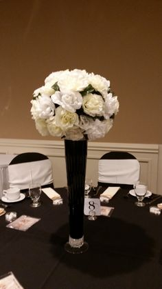Black white and ivory silk flowers with tall black vase with pearls black white and ivory silk flowers with tall black vase with pearls around top and mightylinksfo Image collections