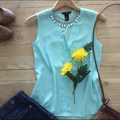   H&M Top Pretty lime semi-sheer sleeveless top.  Third photo shows colors most accurately.  100% polyester.  In great condition. H&M Tops