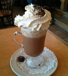 Coffee drinks recipes for every occasion - including this Cafe Mocha with whipped cream and chocolate shavings.