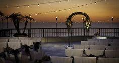 Sunset wedding at Hilton Marco Island Beach Resort & Spa in Marco Island, Fla.