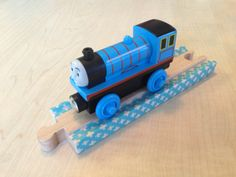 Washi tape on Brio wooden train tracks by woodpeckers.